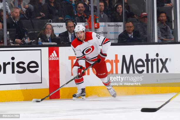 Elias Lindholm of the Carolina Hurricanes skates with the puck against the San Jose Sharks at SAP Center on December 7 2017 in San Jose California