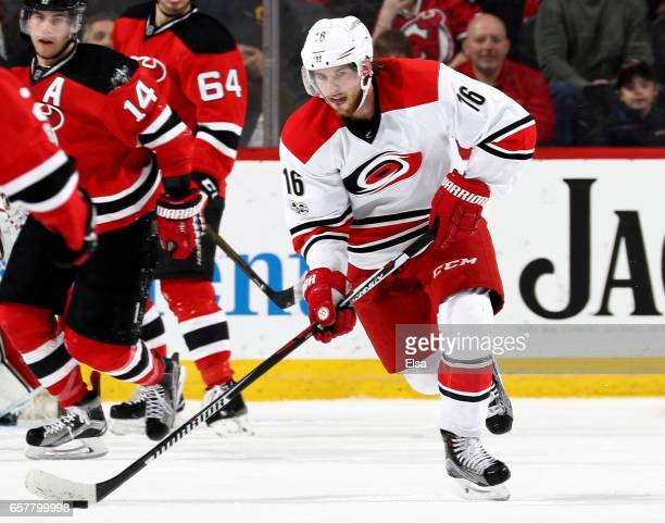 Elias Lindholm of the Carolina Hurricanes takes the puck in the third period against the New Jersey Devils on March 25 2017 at Prudential Center in...