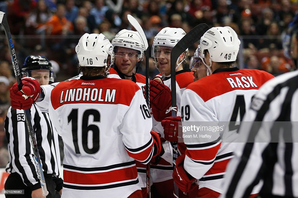 <a gi-track='captionPersonalityLinkClicked' href=/galleries/search?phrase=Elias+Lindholm&family=editorial&specificpeople=8613151 ng-click='$event.stopPropagation()'>Elias Lindholm</a> #16 of the Carolina Hurricanes, <a gi-track='captionPersonalityLinkClicked' href=/galleries/search?phrase=Victor+Rask&family=editorial&specificpeople=7832289 ng-click='$event.stopPropagation()'>Victor Rask</a> #49 of the Carolina Hurricanes, <a gi-track='captionPersonalityLinkClicked' href=/galleries/search?phrase=Noah+Hanifin&family=editorial&specificpeople=13708549 ng-click='$event.stopPropagation()'>Noah Hanifin</a> #5 of the Carolina Hurricanes, and <a gi-track='captionPersonalityLinkClicked' href=/galleries/search?phrase=Eric+Staal&family=editorial&specificpeople=202199 ng-click='$event.stopPropagation()'>Eric Staal</a> #12 of the Carolina Hurricanes react after a goal during the second period of a game against the Anaheim Ducks at Honda Center on December 11, 2015 in Anaheim, California.