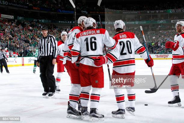 Elias Lindholm Sebastian Aho and the Carolina Hurricanes celebrate a goal against the Dallas Stars at the American Airlines Center on February 11...