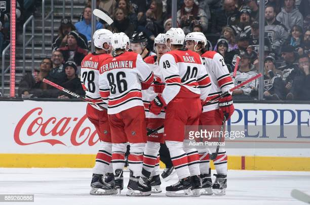Elias Lindholm Teuvo Teravainen and Victor Rask of the Carolina Hurricanes celebrate after scoring a goal against the Los Angeles Kings at STAPLES...
