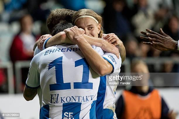 Elias Mar Omarsson of IFK Goteborg Emil Salomonsson of IFK Goteborg and Martin SmedbergDalence of IFK Goteborg celabrates a goal during the...
