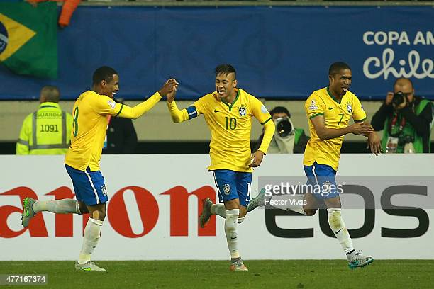 Elias Neymar and Douglas Costa of Brazil celebrate during the 2015 Copa America Chile Group C match between Brazil and Peru at Municipal Bicentenario...