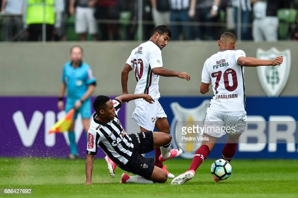 Elias of Atletico MG and Sornoza and Richarlison of Fluminense battle for the ball during a match between Atletico MG and Fluminense as part of...