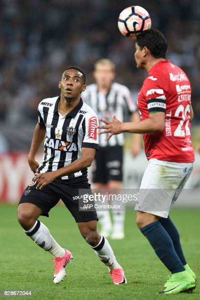 Elias of Brazil's Atletico Mineiro vies for the ball with Edward Zenteno of Bolivia's Jorge Wilstermann during their 2017 Copa Libertadores match...