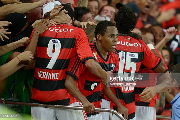 Elias of Flamengo celebrates a scored goal with fans during the match between Flamengo and Botafogo as part of the Brazilian Serie A championship at...