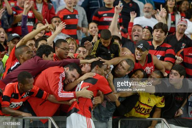 Elias of Flamengo celebrates with fans during the match between Flamengo and Botafogo as part of the Brazilian Serie A championship at the Maracana...
