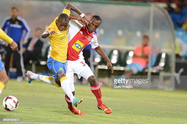 Elias Pelembe of Mamelodi Sundowns and Carl Lark of Ajax Cape Town during the Absa Premiership match between Mamelodi Sundowns and Ajax Cape Town at...
