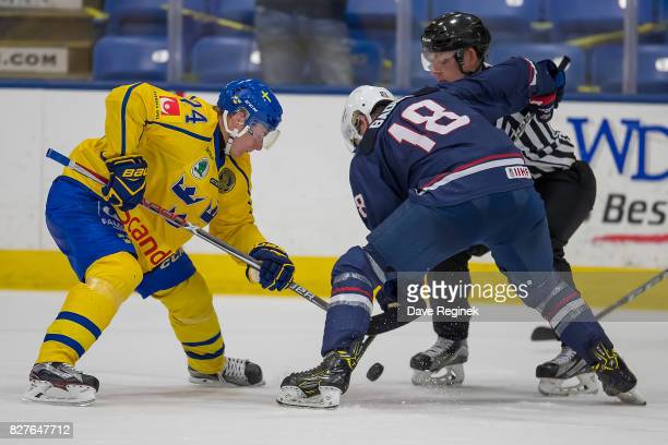 Elias Pettersson of Sweden faces off against Jack Badini of the USA during a World Jr Summer Showcase game at USA Hockey Arena on August 2 2017 in...