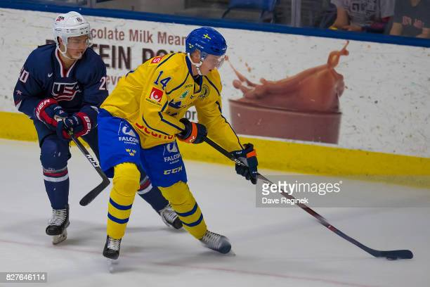 Elias Pettersson of Sweden protects the puck from Josh Norris of the USA during a World Jr Summer Showcase game at USA Hockey Arena on August 2 2017...