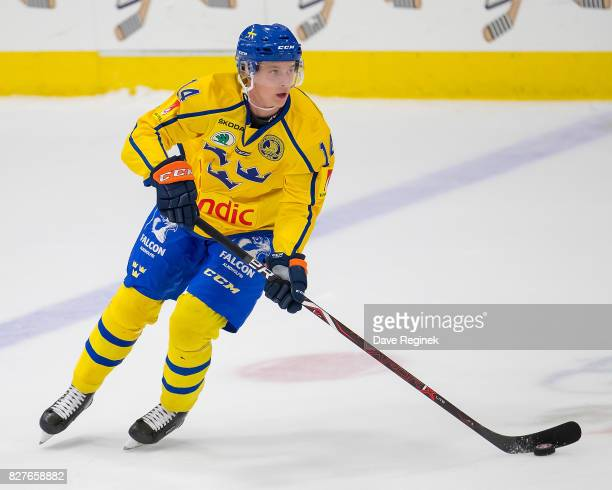 Elias Pettersson of Sweden turns up ice with the puck against USA during a World Jr Summer Showcase game at USA Hockey Arena on August 2 2017 in...