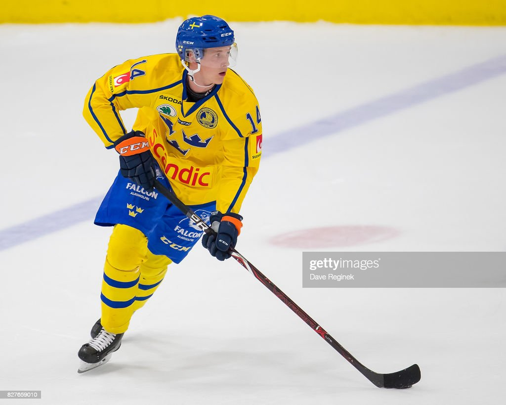 Elias Pettersson #14 of Sweden turns up ice with the puck against USA during a World Jr. Summer Showcase game at USA Hockey Arena on August 2, 2017 in Plymouth, Michigan. The USA defeated Sweden 3-2. (Photo by Dave Reginek/Getty Images) Elias Pettersson