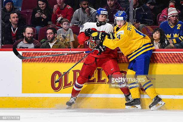Elias Pettersson of Team Sweden holds back Martin Necas of Team Czech Republic during the 2017 IIHF World Junior Championship preliminary round game...