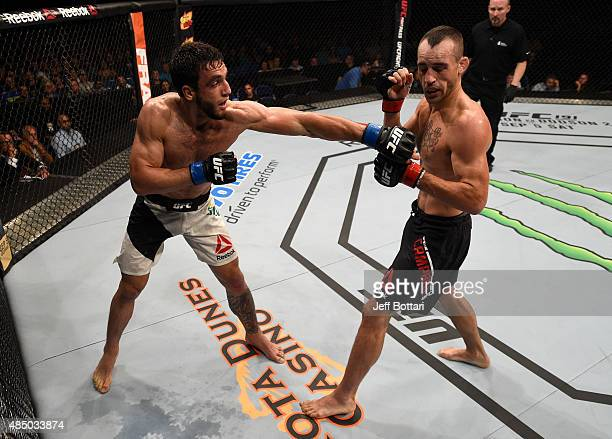 Elias Silverio of Brazil punches Shane Campbell in their lightweight bout during the UFC event at the SaskTel Centre on August 23 2015 in Saskatoon...