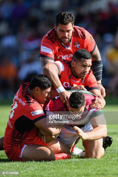 Elias Sukkar of Lebanon is tackled during the 2017 Rugby League World Cup Quarter Final match between Tonga and Lebanon at AMI Stadium on November 18...