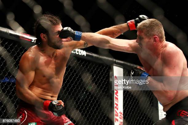 Elias Theodorou of Canada and Daniel Kelly of Australia exchange punches in their middleweight bout during the UFC Fight Night at Qudos Bank Arena on...