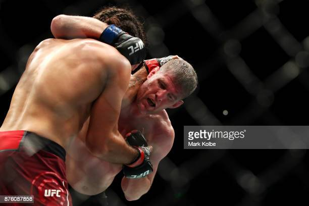 Elias Theodorou of Canada and Daniel Kelly of Australia grapple in their middleweight bout during the UFC Fight Night at Qudos Bank Arena on November...