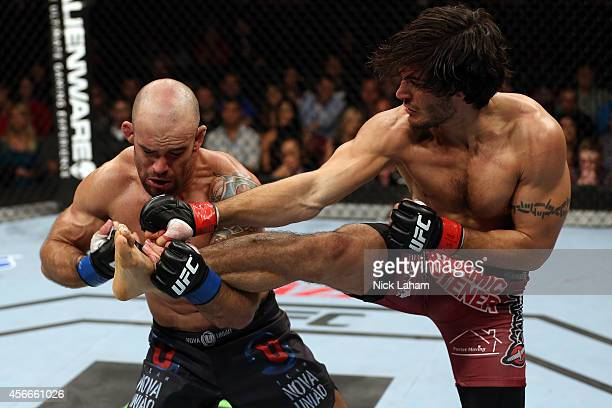 Elias Theodorou of Canada kicks Bruno Santos of Brazil in their middleweight bout at the Scotiabank Centre on October 4 2014 in Halifax Nova Scotia...