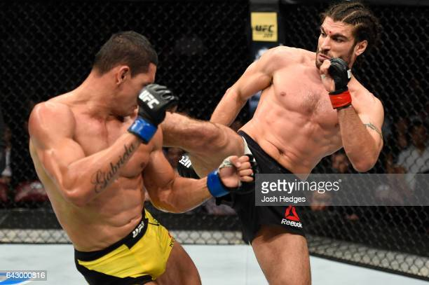 Elias Theodorou of Canada kicks Cezar Ferreira of Brazil in their middleweight fight during the UFC Fight Night event inside the Scotiabank Centre on...