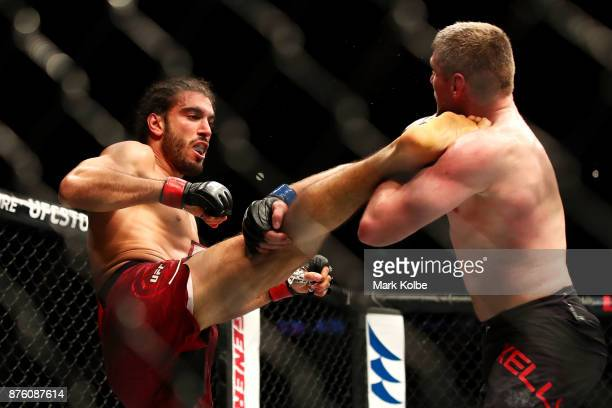 Elias Theodorou of Canada kicks Daniel Kelly of Australia in their middleweight bout during the UFC Fight Night at Qudos Bank Arena on November 19...
