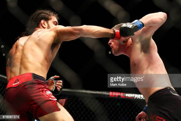 Elias Theodorou of Canada punches Daniel Kelly of Australia in their middleweight bout during the UFC Fight Night at Qudos Bank Arena on November 19...