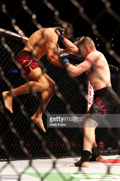 Elias Theodorou of Canada uses the cage to jump at Daniel Kelly of Australia in their middleweight bout during the UFC Fight Night at Qudos Bank...