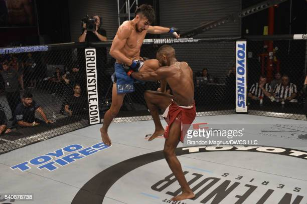 Elias Urbina lands a flying knee to the face of Bevon Lewis in their middleweight bout during Dana White's Tuesday Night Contender Series at the TUF...