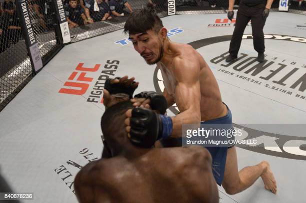Elias Urbina punches Bevon Lewis in their middleweight bout during Dana White's Tuesday Night Contender Series at the TUF Gym on August 29 2017 in...
