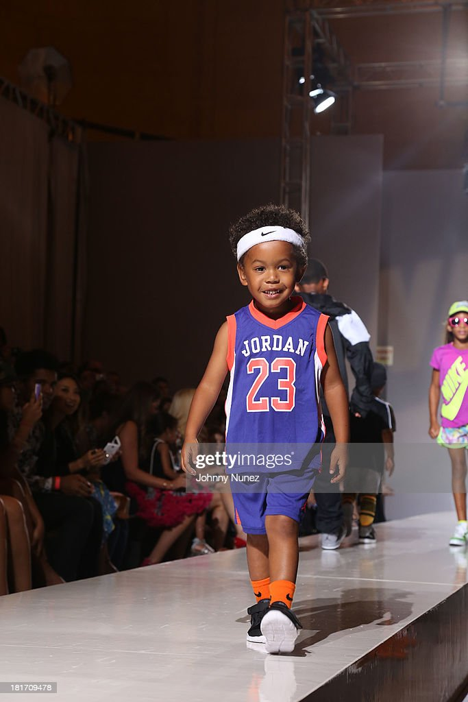 Elias Washington on the runway during the Kids Rock! Celebrity Fashion Show at Grand Central Terminal on September 11, 2013 in New York City.