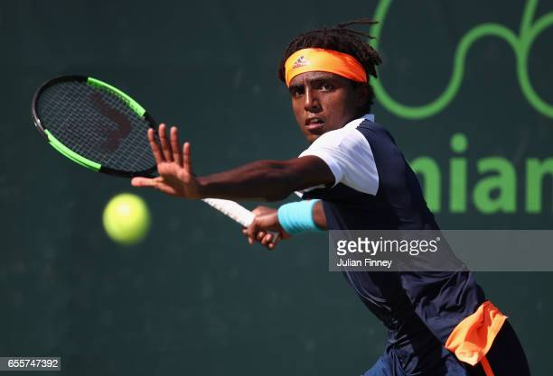 Elias Ymer of Sweden in action against Radu Albot of Moldova in his qualifying round match against at Crandon Park Tennis Center on March 20 2017 in...