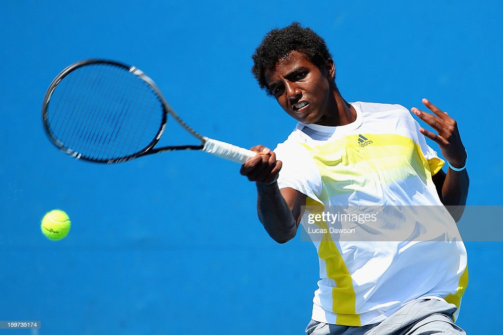 Elias Ymer of Sweden plays a forehand in his first round match against Ku Keon Kang of Korea during the 2013 Australian Open Junior Championships at Melbourne Park on January 20, 2013 in Melbourne, Australia.