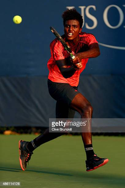 Elias Ymer of Sweden returns a shot against Diego Schwartzman of Argentina during their Men's Singles First Round match on Day One of the 2015 US...