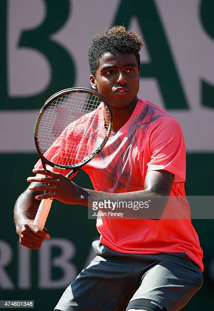 Elias Ymer plays a forehand during his Men's Singles match against Lukas Rosol of Czech Republic on day one of the 2015 French Open at Roland Garros...
