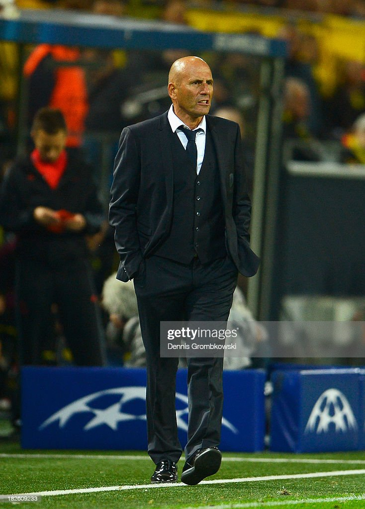 <a gi-track='captionPersonalityLinkClicked' href=/galleries/search?phrase=Elie+Baup&family=editorial&specificpeople=536928 ng-click='$event.stopPropagation()'>Elie Baup</a>, coach of Olympique Marseille looks on during the UEFA Champions League Group F match between Borussia Dortmund and Olympique de Marseille at Signal Iduna Park on October 1, 2013 in Dortmund, Germany.