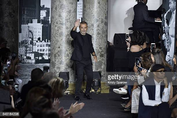 Elie Saab acknowledges the audience during the Elie Saab Haute Couture Fall/Winter 20162017 show as part of Paris Fashion Week on July 6 2016 in...