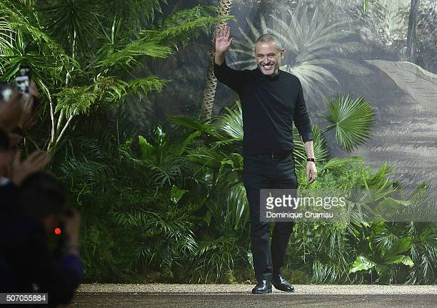 Elie Saab aknowledges the applause after his show as part of Paris Fashion Week on January 27 2016 in Paris France