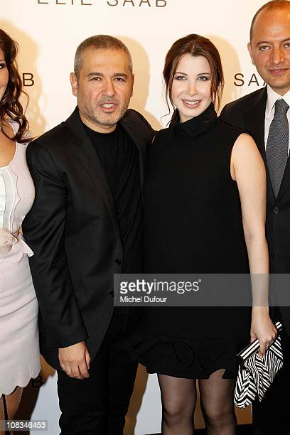 Elie Saab and Nancy Ajram attend the Elie Saab show as part of the Paris Haute Couture Fashion Week Spring/Summer 2011 at Palais de Chaillot on...