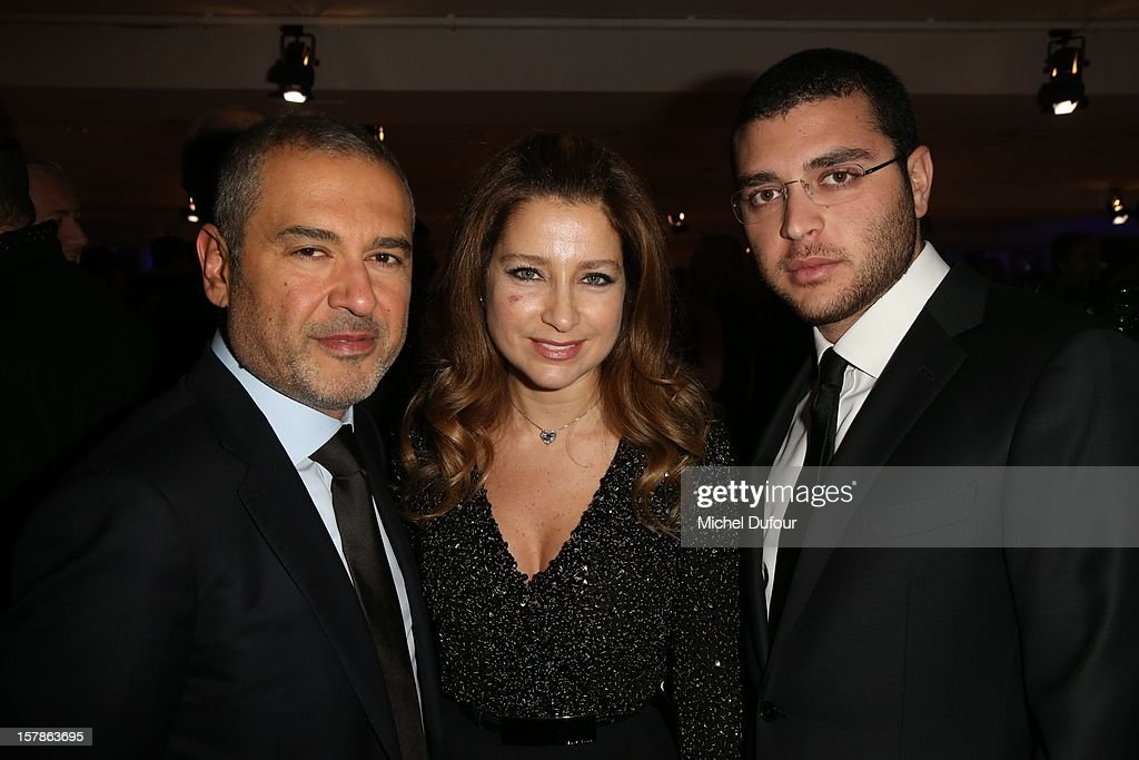 Elie Saab, his wife and his son attend the Babeth Djian Hosts Dinner For Rwanda To The Benefit Of A.E.M. on December 6, 2012 in Paris, France.
