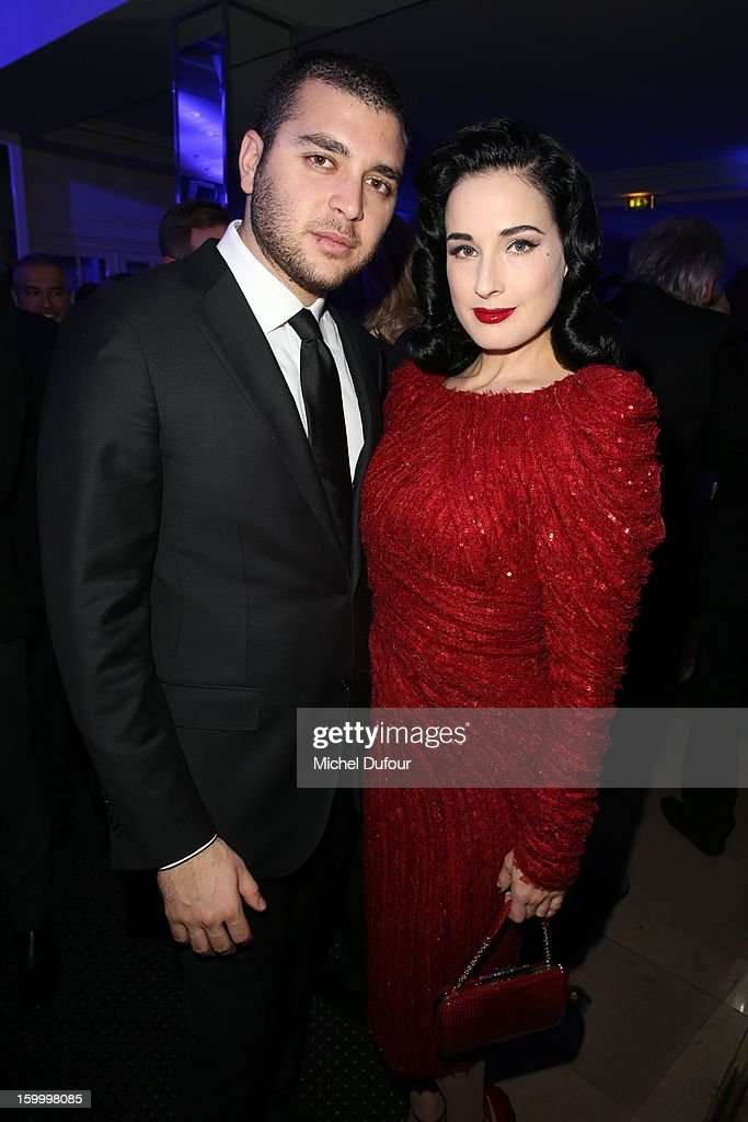 Elie Saab Jr. and Dita von Teese attend the Sidaction Gala Dinner 2013 at Pavillon d'Armenonville on January 24, 2013 in Paris, France.