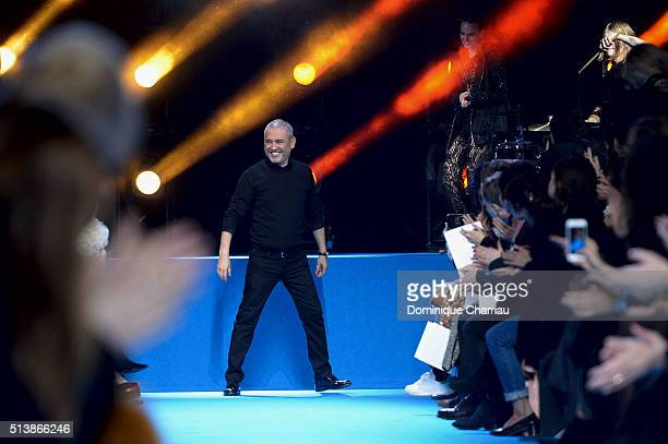 Elie Saab poses on the runway during the Elie Saab show as part of the Paris Fashion Week Womenswear Fall/Winter 2016/2017 on March 5 2016 in Paris...