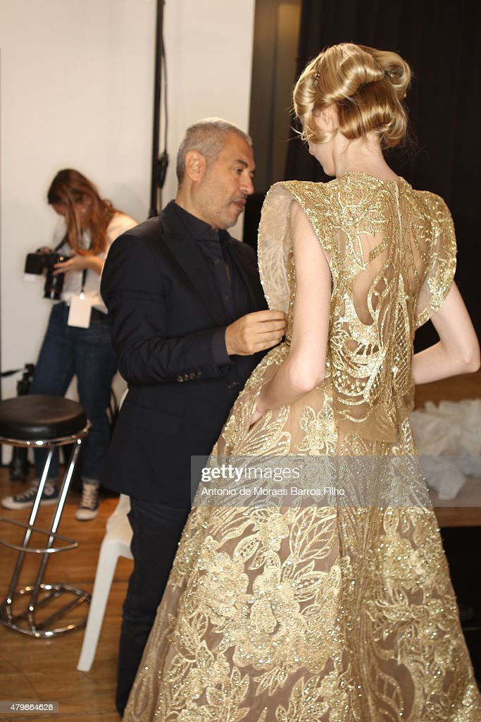 Elie Saab prepares model backstage prior to Elie Saab show as part of Paris Fashion Week Haute-Couture Fall/Winter 2015/2016 on July 8, 2015 in Paris, France.