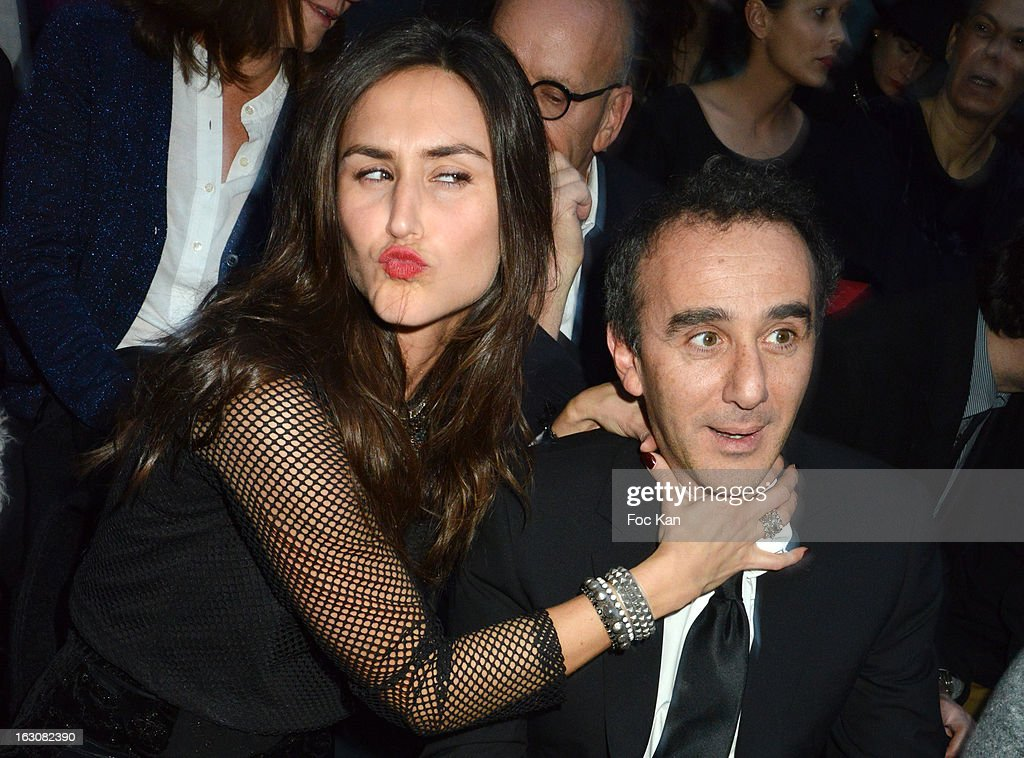 Elie Semoun (R) and a guest attend the John Galliano - Front Row - PFW F/W 2013 at Le Centorial on March 3, 2013 in Paris, France.