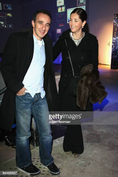 Elie Semoun and Cristiana Reali attend the Toshiba 'Go to Space' party at Palais De Tokyo on December 14 2009 in Paris France