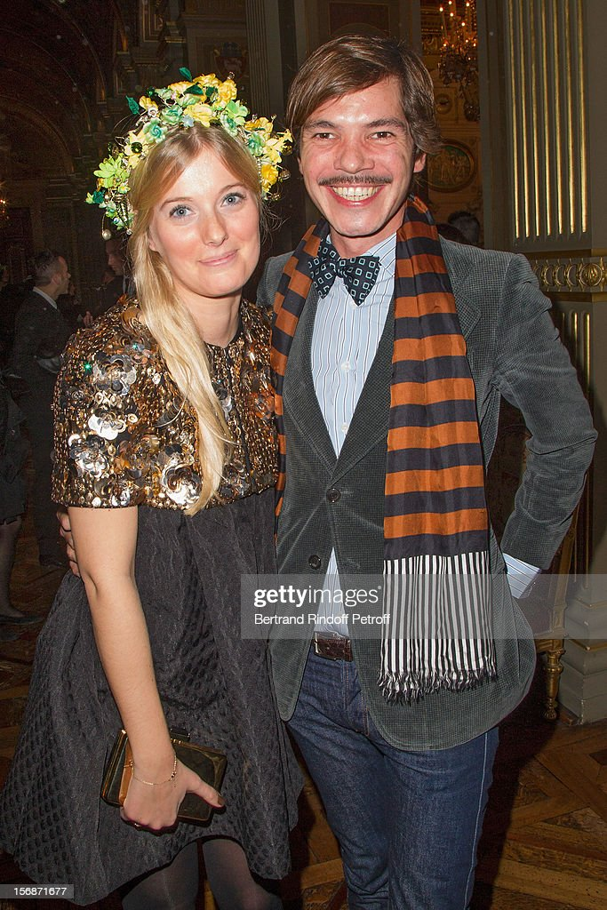 Elie Top (R), Lanvin fashion house's jewelry designer, and a young Lanvin employee pose at the Paris City Hall during the Sainte-Catherine Celebration on November 23, 2012 in Paris, France.