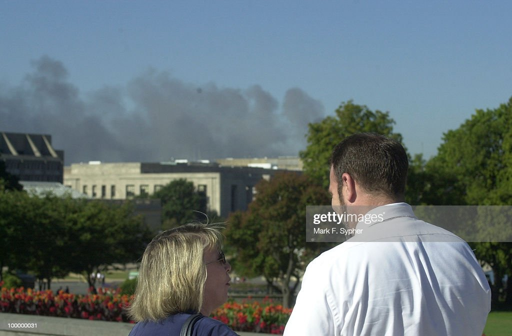 Elieen Milton and John Shaw watch the Pentagon smoke from the U.S. Capitol after the announcement of evacuation.
