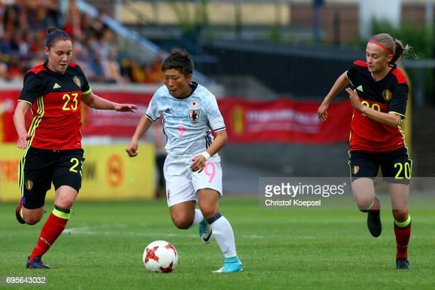Elien van Wynendaele of Belgium and Julie Biesmans of Belgium challenge Kumi Yokoyama of Japan during the Women's International Friendly match...