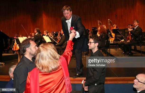 Eliette von Karajan widow of Herbert von Karajan gives conductor Christian Thielemann a red rose during the 'Herbert von Karajan award' while the...