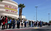 Eligible caucus attendees line up at Del Sol High School in Las Vegas to participate in First in the West presidential caucus on February 20 2016 /...