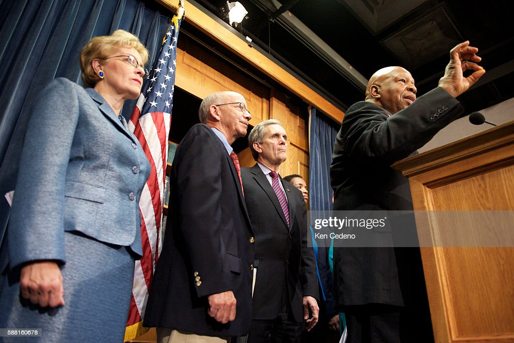 Elijah Cummings US representative from Maryland speaks at a news conference on the economic rescue plan at the Capitol in Washington DC Listening are...