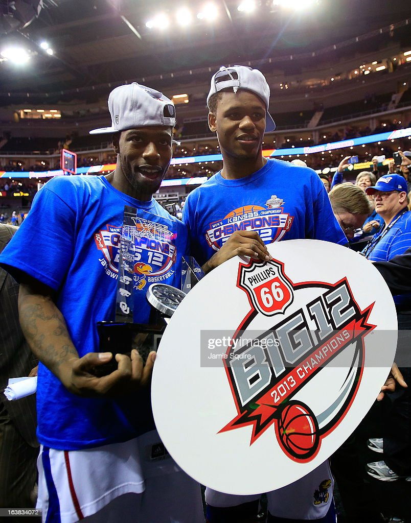 Elijah Johnson #15 and Ben McLemore #23 of the Kansas Jayhawks celebrate their 70-54 win over Kansas State Wildcats during the Final of the Big 12 basketball tournament at Sprint Center on March 16, 2013 in Kansas City, Missouri.